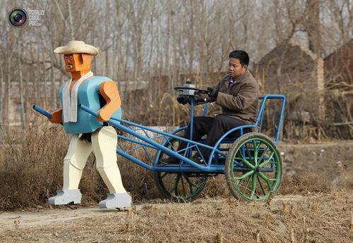 Weird Inventions Made by the Chinese. Farmer Wu Yulu, 48, rides in a cart pulled by his walking robot