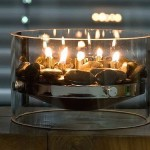 Short candles in a glass bowl