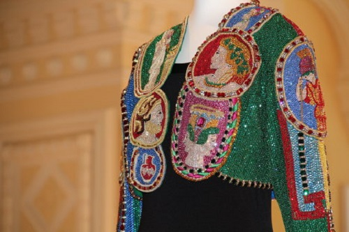 Versace bolero, decorated with Greek profiles. Taylor had several boleros in her collection. Embellished with her sequin-made portraits and ancient profiles. She wore this one during a charity event for her AIDS foundation in 1992