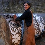 Gorgeous blacksmith Cal Lane working on her new project