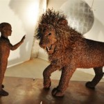 A boy and a lion, detail. Iron sculptures by Italian artist Mattia Trotta