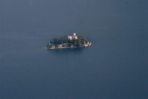 Fabulous view of Loreto Island with an ancient castle on Lake Iseo in northern Italy
