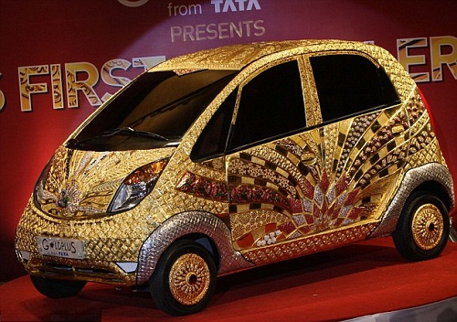 'Nano' car crafted in gold, silver and gem stones in Mumbai, India, and below the amount of precious metals and stones used in the one-off design is shown clearly side on