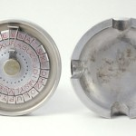 Secret Cipher Ashtray. Circa 1930-1940, Unknown Issuer. Disguised in full view as an ashtray, this device could be used to encipher and decipher messages.