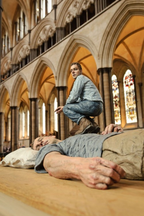 Lilliputs and giants. Surreal art installation by British sculptor Sean Henry