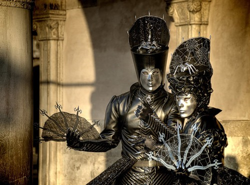 Participants of Venice Carnival, with fans