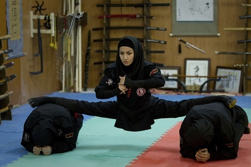 Flexible woman from the Ninja army