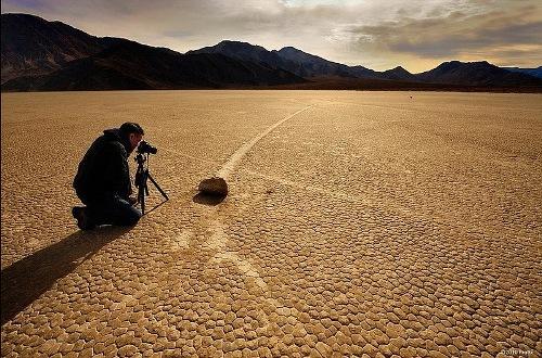 A photographer, fixing the fact