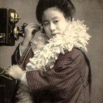 Photo of Geisha with a telephone