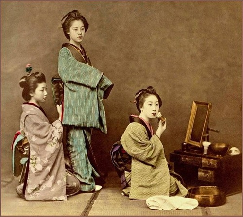 Three female Japanese entertainers, known as Geisha
