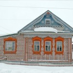Winter view of wood lace decorated country house by Konstantin Muratov