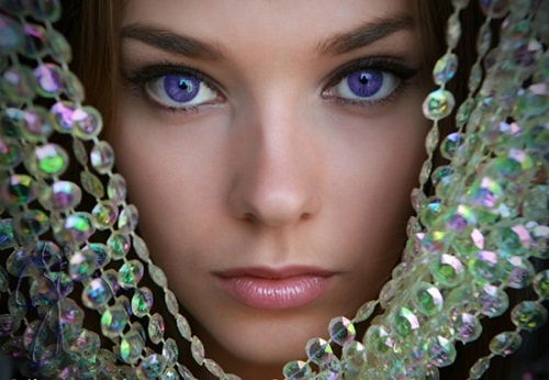 Gorgeous woman in crystal beads