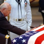 Mikhail Gorbachev touches the casket containing the remains of former US president Ronald Reagan at the Rotunda of the Capitol Building in Washington, DC 10, June 2004.