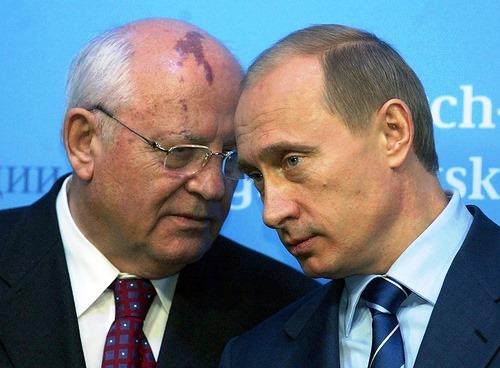 Russian President Vladimir Putin talks to former Soviet President Mikhail Gorbachev 21 December 2004