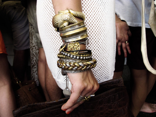 It's easy to wear white head to toe if you simply add a bold piece of jewelry or other accessory. Christy James