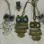 A set of owl pendants
