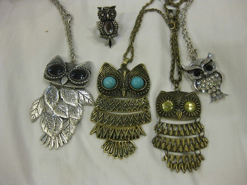 A set of owl pendants