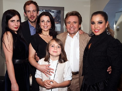 At the Royal Albert Hall, May 2011, with two of his daughters, Annabel, left, next to her Jessica and far right, his wife Jessica Pacheco