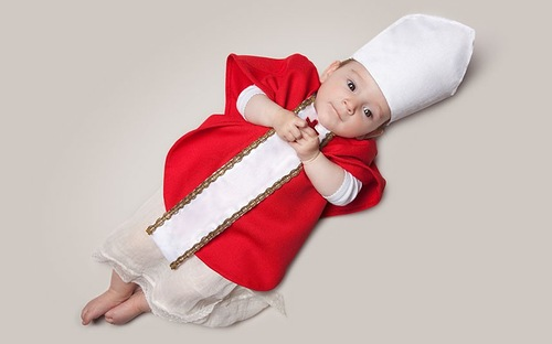 Baby June dressed as a bishop. Photo project by American photo artist Eric Maloberti
