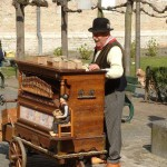 Barrel organ player in England