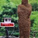 42 year-old Wang Dalin stands with bees covering his body on a weighing scale during a 'bee-bearding' competition