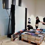 Arranging an art exhibition. Book installation by American artist Mike Stilkey