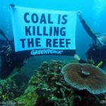 """Dr John 'Charlie' Veron dive for an underwater protest in the Great Barrier Reef and place a banner reading """"Coal is killing the reef"""""""