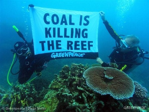 "Dr John 'Charlie' Veron dive for an underwater protest in the Great Barrier Reef and place a banner reading ""Coal is killing the reef"""