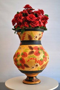 Colorful birthday cake for a Russian family! It reminds you of all the Russian lacquerware that is Russian heritage. The flowers lift off and you can save them as a centerpeice and dive into this delicious cake