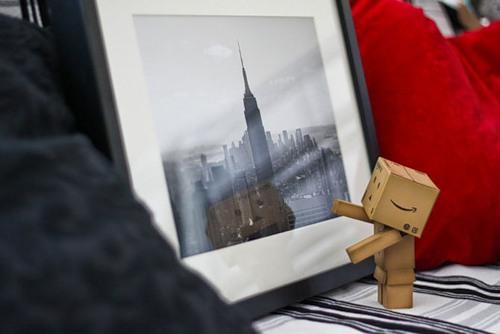 Admiring skyscraper Cardboard man Danbo, photo by Anton Tang, Singapore
