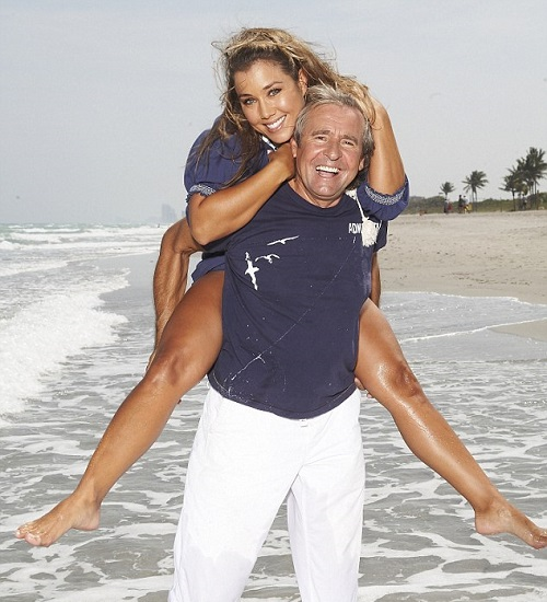 With his third wife, Jessica Pacheco, pose near their home in Florida