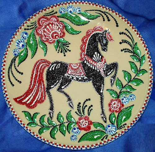 Decorative plate painted in 'point-to-point' technique by Russian artist of applied art Irina