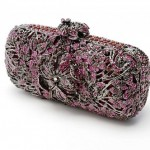Orchid. An exquisite hand-sculpted floral minaudiere entwined with flowers and vines