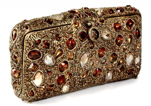 A drop-dead beautiful minaudiere fashioned of various shaped stones. Hand-sewn silk lining, Swarovski crystals
