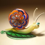 Beautiful snail. Glass insect sculptures by American artist Wesley Fleming