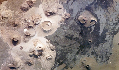 Harrat Khaybar in Saudi Arabia contains a wide range of volcanic rock types and spectacular landforms, several of which are represented in this photograph taken by an astronaut abourd the International Space Station on March 31, 2008