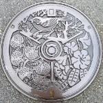 Japanese artful manhole covers symbolism