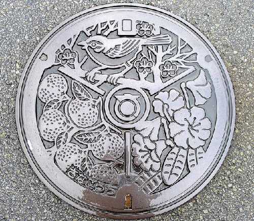 Japanese artful manhole covers symbolism. Japanese photographer MRSY