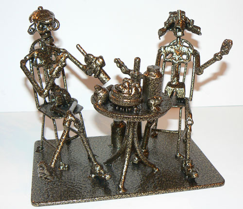 Two men drinking at the table. Scene of village live - a man and his dog. Nuts and bolts sculpture by Siberian artist Aleksey Petrov