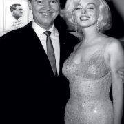 Promoter Earl Blackwell and Marilyn Monroe in a dress embroidered with 10 thousand Swarovski crystals, 1962