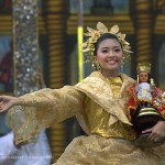 Wearing golden clothes, participant of Sinulog festival