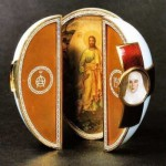 The Red Cross with Triptych egg is an enameled Easter egg made under the supervision of the Russian jeweler Peter Carl Faberge in 1915
