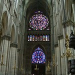 Two rose windows on the west end of Notre-Dame de Reims (Our Lady of Reims) – the seat of the Archdiocese of Reims, where the kings of France were crowned