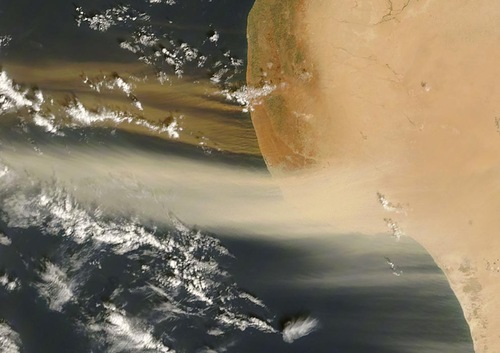 Two-toned dust plumes blew northward off the coast of Libya on October 26, 2007, as the MODIS instrument on NASA's Terra satellite took this picture. While plumes in the west are beige, reminiscent of the Sahara's sands, the plumes in the east are distinctly darker