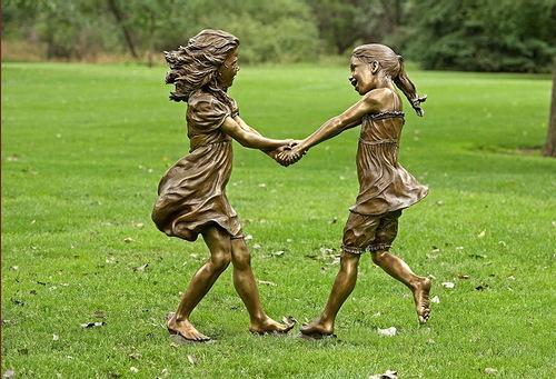 Bronze sculpture of dancing girls