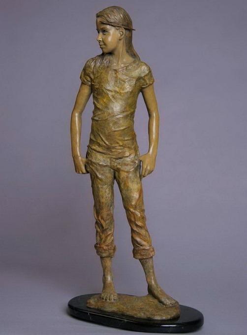 A child. Sculpture by American artist Angela Mia De La Vega