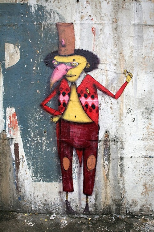 Triumph of the street art of Brazilian twins Os Gemeos. Brazilian artists Os Gemeos (Otavio and Gustavo Pandolfo)