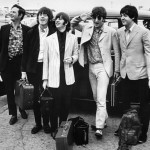 A portrait of The Beatles with their manager, Brian Epstein, arriving in London where they are welcomed by a crowd of two hundred fans