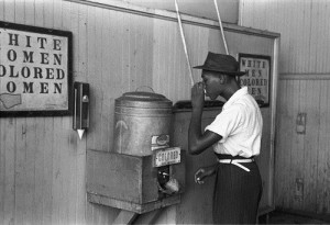 "An African-American man drinking at a ""colored"" drinking fountain in a streetcar terminal in Oklahoma City, Oklahoma, 1939"