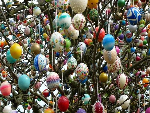 Beautiful patterns of Easter eggs. Apple tree in Eastern Germany